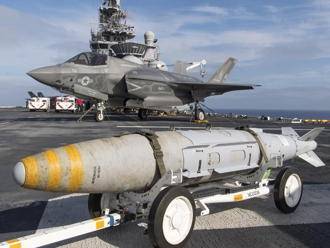 An F-35 undergoes operational testing aboard a US Marine amphibious assault carrier last year. The stealth fighter's abilities are limited by the need for stealth. Picture: US Navy