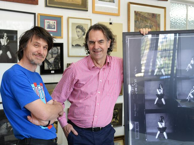 Morley's publisher Tom Thompson (right) with the photographer's son Lewis Morley and some of the items to be auctioned.