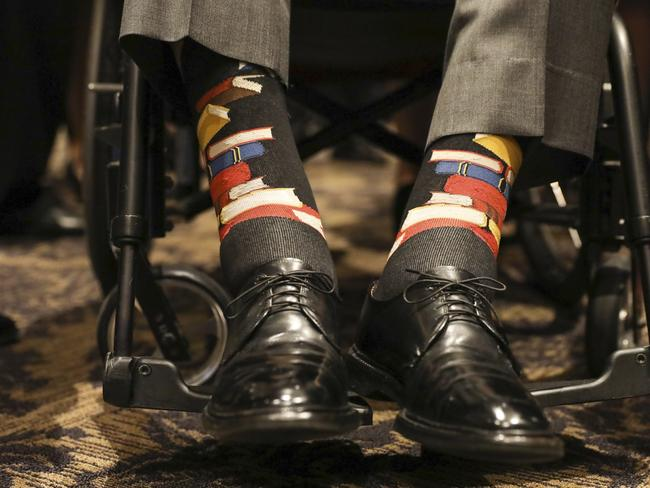 George H.W. Bush wore socks patterned with a book motif to wife Barbara's funeral in honour of her work promoting literacy. Picture: Paul Morse/Courtesy of Office of George H.W. Bush via AP