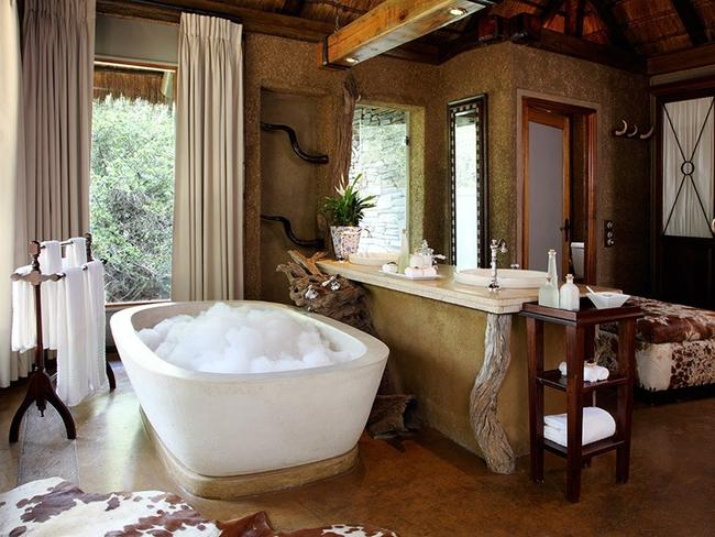 "CAMP JABULANI, SOUTH AFRICA: See the Big Five in ultimate luxury at this reserve where you'll get your wildlife fix with the added comforts that only a La Prairie Spa and private butler can bring. Spread over 10,000ha, the five-star lodge houses a herd of rescue elephants which are now used for safaris (guests are seated on their backs and led through the bush). And in between wildlife encounters guests can relax in one of the six luxurious suites that come complete with private outdoor deck and pool. Jabulani is Zulu for ""happiness"" and it's fair to say that you'll be pretty pleased with yourself after a few days here. campjabulani.com Picture: Rikki Hibbert Photography"