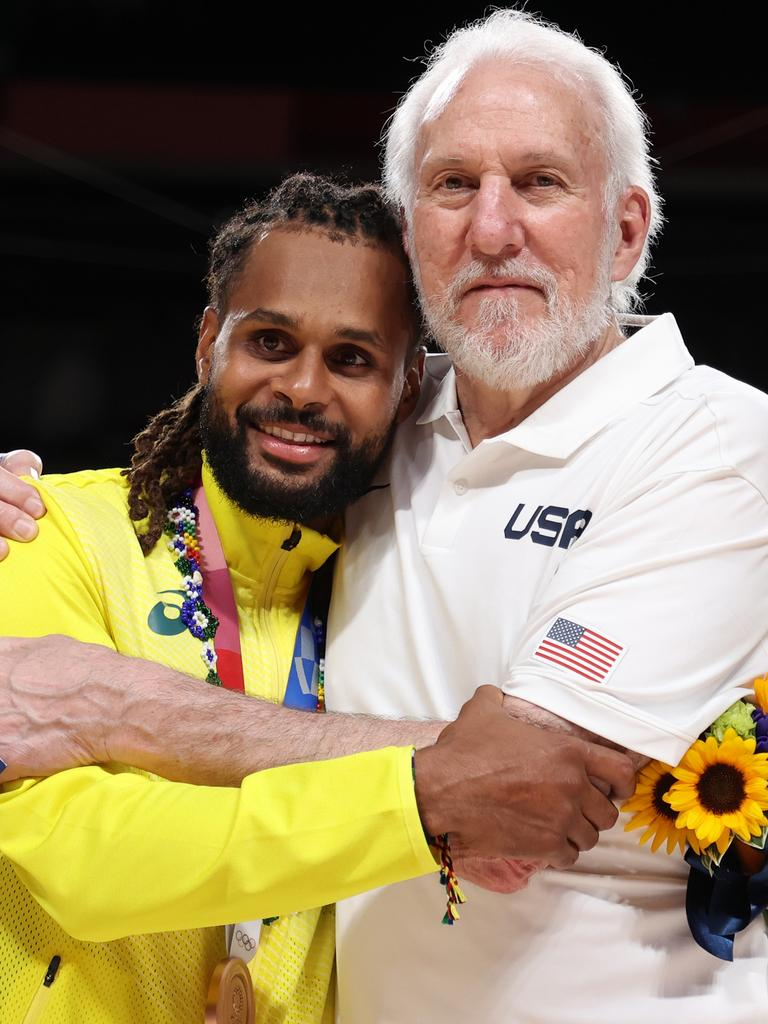 Team United States Head Coach Gregg Popovich poses with Team Australia's Patty Mills. Photo: Getty Images.