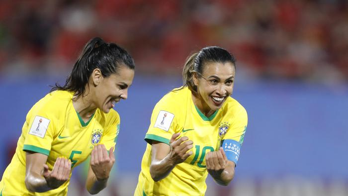 Brazil's Marta (r) is now the all-time leading scorer in World Cup history