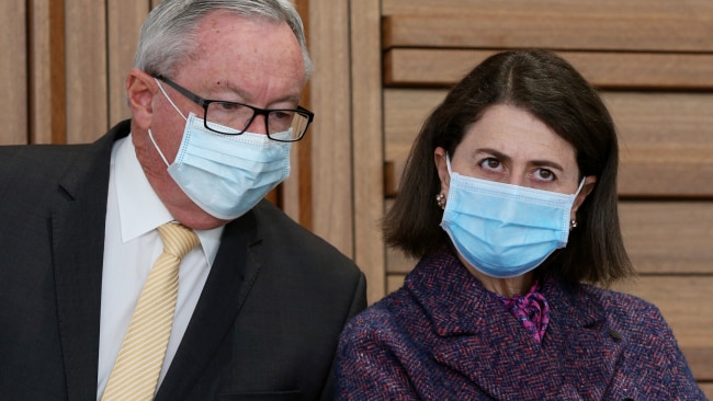 NSW Minister for Health Brad Hazzard and Premier Gladys Berejiklian are seen during a daily COVID-19 update. Photo: Lisa Maree Williams Pool/Getty Images
