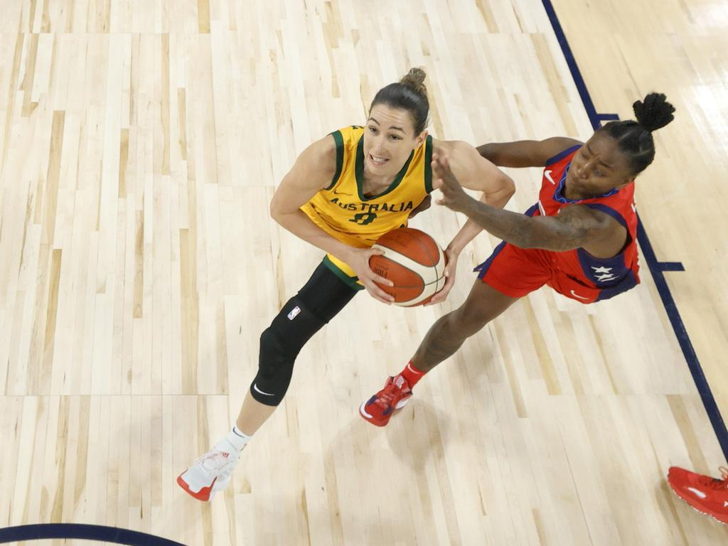 Bec Allen #9 of the Australia Opals drives to the basket against Jewell Loyd #4 of the United States. Picture: Ethan Miller/Getty Images/AFP