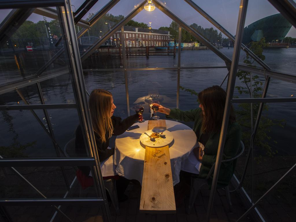 The Mediamatic restaurant allows diners to sit in small glasshouses. Picture: AP Photo/Peter Dejong