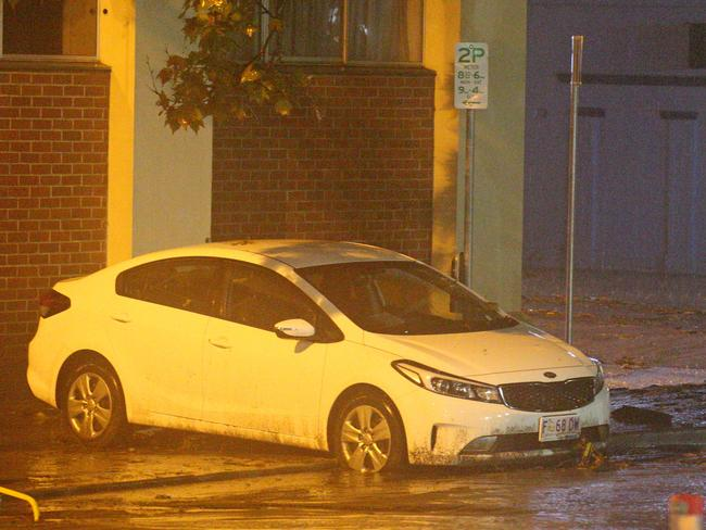 A car in Campbell St turned by the force of stormwater flowing from the Hobart Rivulet after it burst it banks overnight. Picture: PATRICK GEE