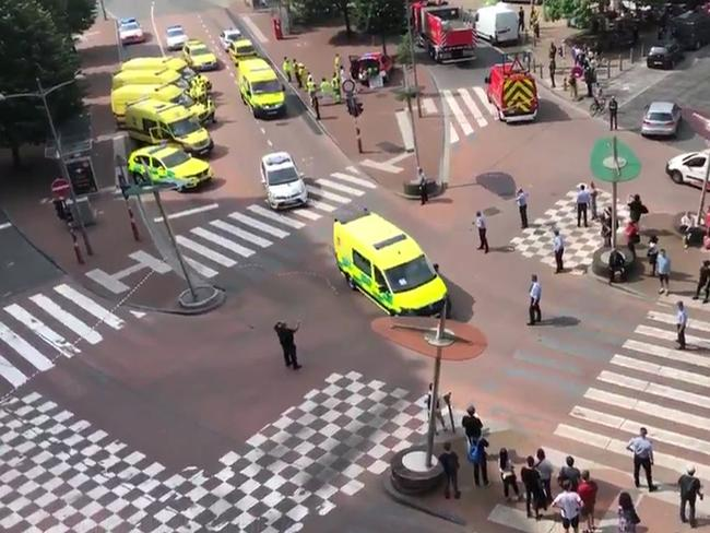Police block a crossroad in the eastern Belgian city of Liege, after a gunman shot dead three people, two of them policemen, before being killed by elite officers.