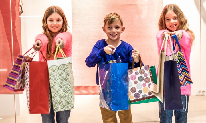 Children love to buying things at the sale in shopping mall