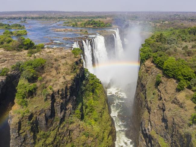 VICTORIA FALLS, ZIMBABWE Sure, you can get a good feel for the mind-blowing-ness that is Victoria Falls from the ground, hearing its thundering falls and feeling its mist. But, to truly take in and appreciate this natural phenomenon, you'll need to get high above it. Starting with a look at the lazy Zambezi River with its rugged islands and exotic wildlife, your jaw will then drop as the Falls first come into view. Narrow enough to look sliced by a knife, and spouting rainbows, it's no wonder they're often called, well, a world wonder.— Sangeeta Kocharekar
