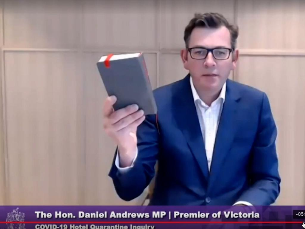 Daniel Andrews with the bible as he was sworn in on Friday.