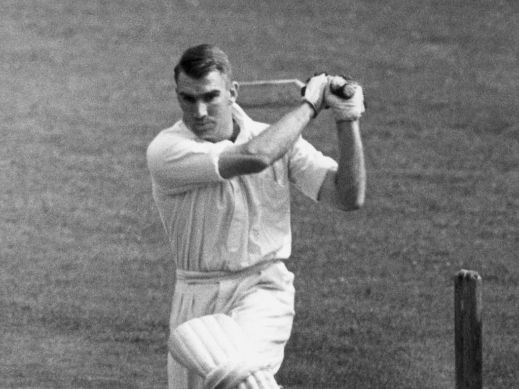 John Reid of New Zealand drives a ball to the boundary.