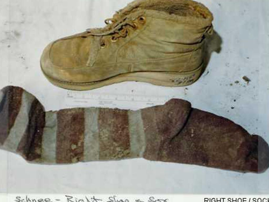 Annette was found with both shoes on, but wearing one orange bootie sock on her left foot and one long striped sock on her right foot.