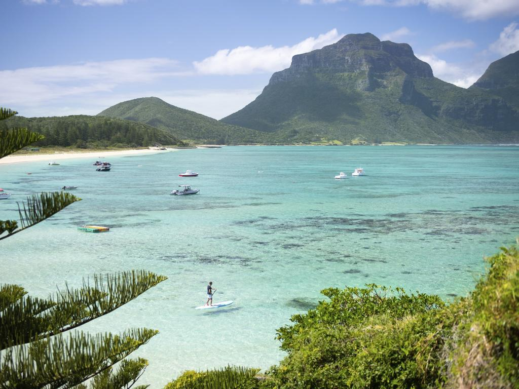 Man stand up paddleboarding off Lagoon Beach with views across to Mount Lidgbird. Lord Howe Island  credit Tom Archer  escape  december 6 2020  top gear