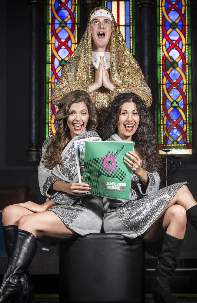 Sisters Celeste Carbone, left, and Deanna Kangas with Two Brunettes and a Gay co-star Aaron Collis and the 2017 Fringe program available in The Advertiser on Saturday. Picture: Mike Burton