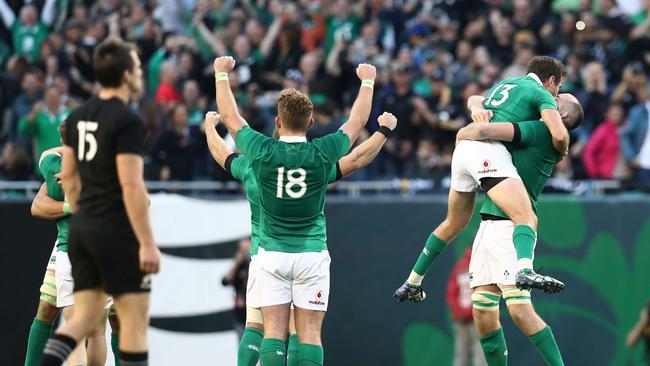 Ireland players celebrate their 40-29 victory as the final whistle blows.