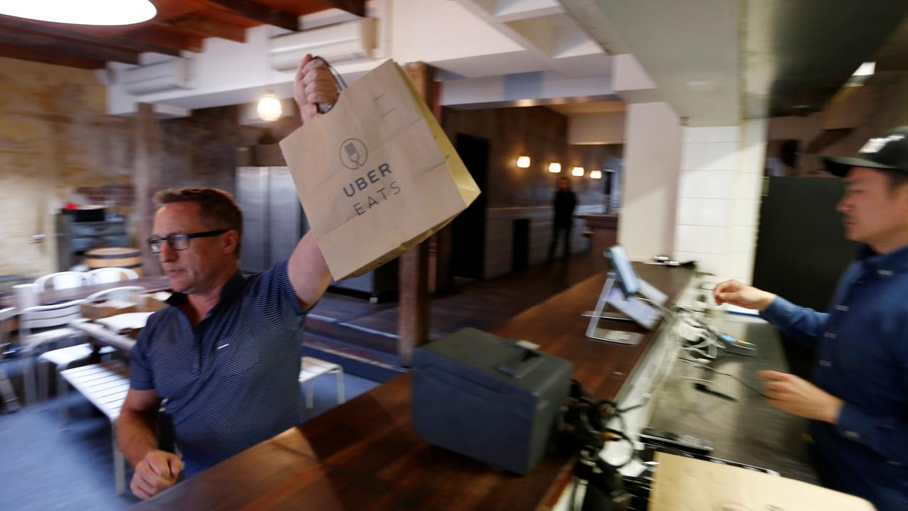 Tony Plunkett, pictured in Australia's first ever 'dark kitchen' — a restaurant run entirely on deliveries by Uber — says after initial success things quickly fell apart. Picture: Jason Reed/Reuters