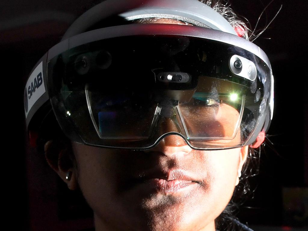 Kimberlyn Selvan, 15, tries out HoloLens mixed reality lenses at SAAB Australia's Future Combat System Laboratory. Picture: Tricia Watkinson