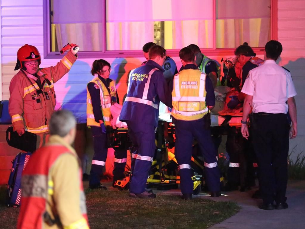 Mr Lindsell is wheeled out on a stretcher by paramedics. Picture: Steve Tyson.