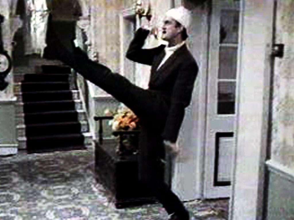 Actor John Cleese as Basil Fawlty doing an impression of Hitler in Fawlty Towers.