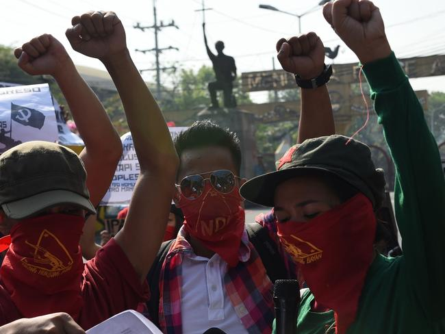 Members and supporters of the communist party of the Philippines' armed group, the New People's Army (NPA) shout slogans during a protest near Malacanang Palace in Manila on March 31, 2017. Picture: Ted Aljibe/AFP