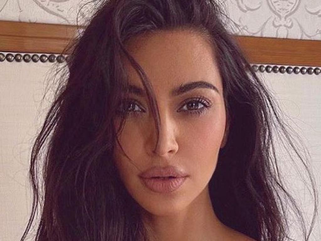 KIM Kardashian turned up the heat for a topless photo in bed. Picture: Instagram