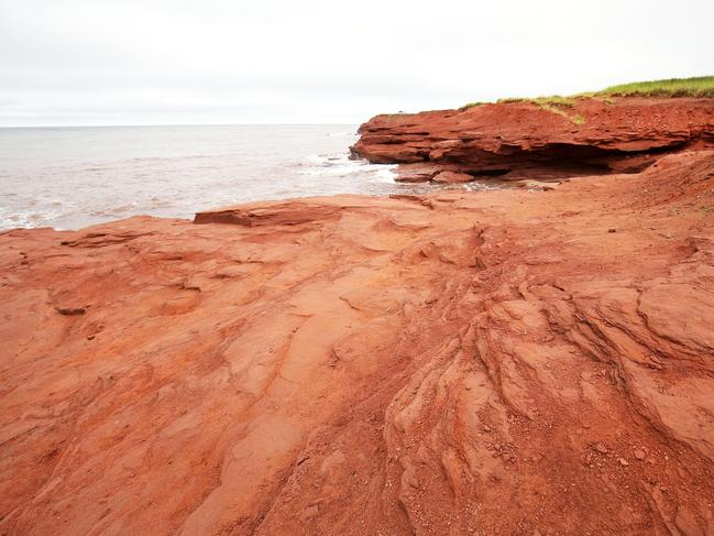 RED SANDS SHORE, PRINCE EDWARD ISLAND Thanks to high iron content in the soil, parts of Prince Edward Island's coastline are emblazoned with red sandstone cliffs, red clay roads and rose-tinted sand beaches. Cavendish Beach is a popular hangout for beachgoers, who can walk around the vibrant cliffs or just take in the views from the shoreline.