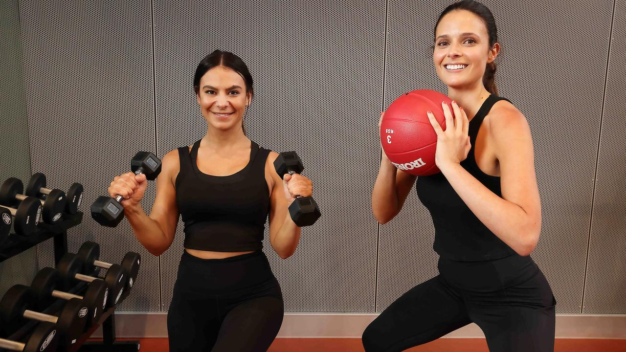 Fotini Veis and Dom Gauci get back to exercising at Foxfit Gym in Cremorne as gym restrictions ease. Picture: Ian Currie