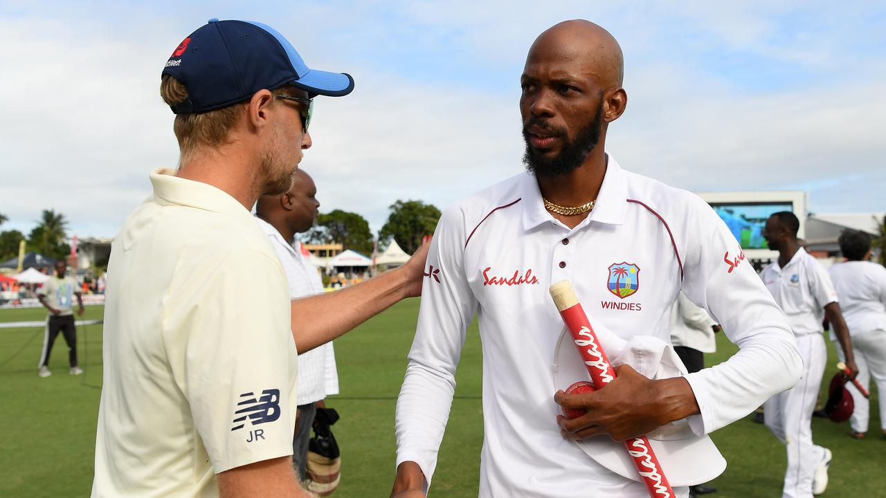 Joe Root shakes Roston Chase's hand, after England's defeat at Bridgetown.