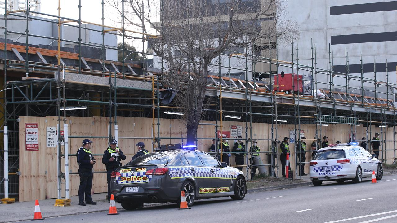 Police officers monitor a CFMMEU protest at Toorak Rd in Hawthorn East. Picture: Wayne Taylor
