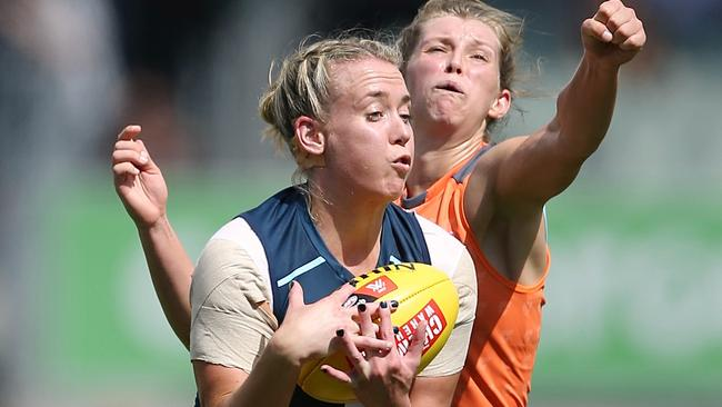 Lauren Arnell marks in front of Maddy Collier. Picture: Wayne Ludbey