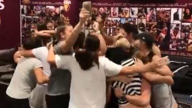 Brisbane players celebrate after making the AFLW Grand Final.