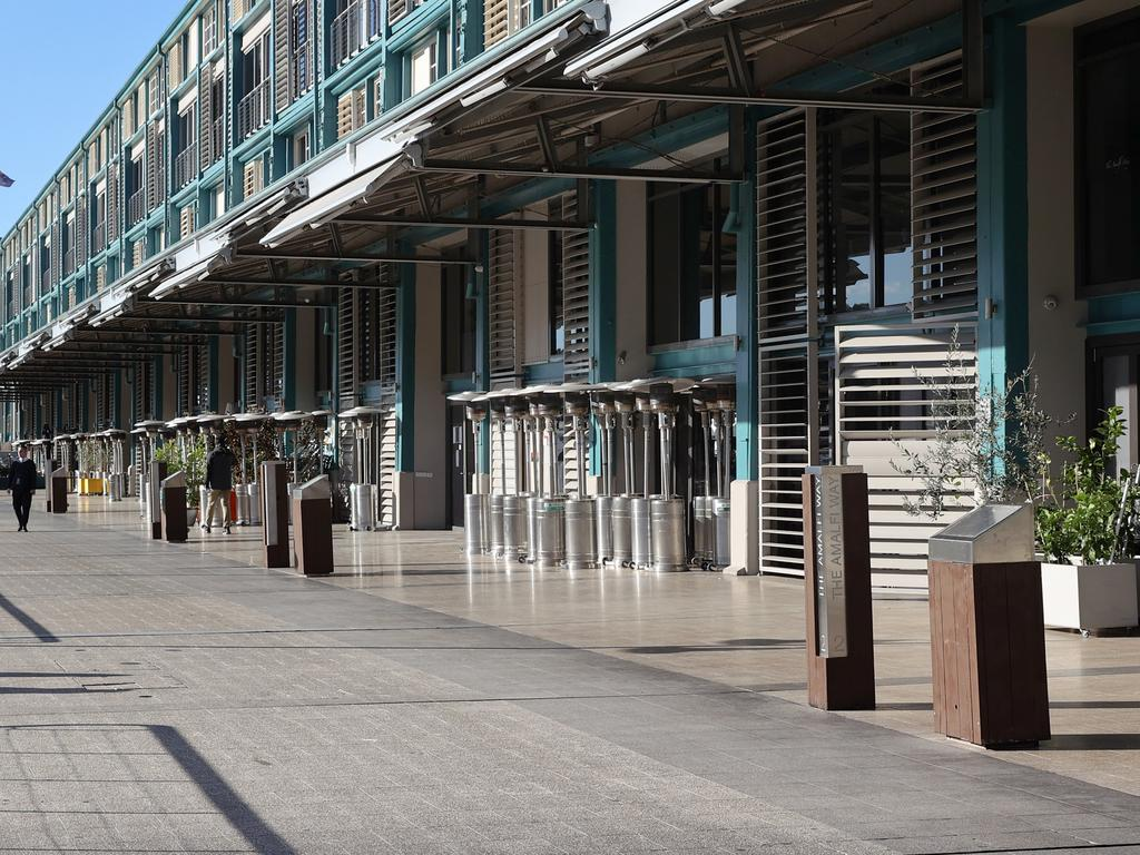 The usually bustling restaurant strip along Woollomooloo Wharf during Sydney's lockdown. Picture: Richard Dobson