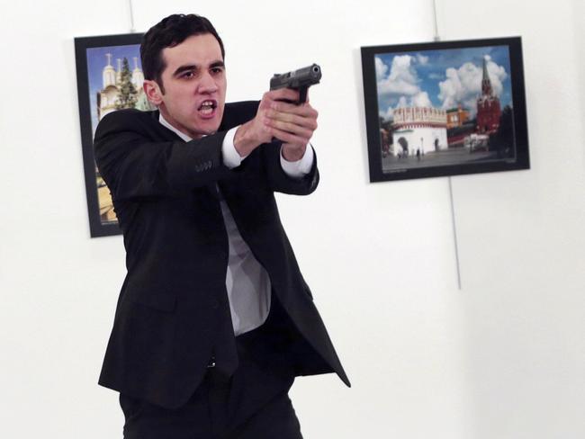 Mevlüt Mert Altıntaş opens fire at a photo gallery in Ankara, Turkey. Picture: AP Photo/Burhan Ozbilici