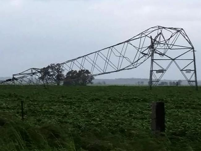 A transmission tower carrying power lines was toppled by high winds near Melrose in South Australia, contributing to a statewide blackout. Picture: Debbie Prosser/AFP