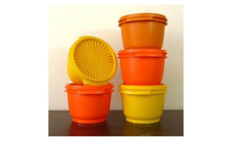 PLASTIC CONTAINERS: If you ever saw a container at your grandparents' house it was either bright orange or bright yellow. The sundial patterned containers were practically indestructible so it's no surprise everyone had one.