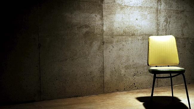 Undated : generic chair in a dingy interrogation room - light shadows