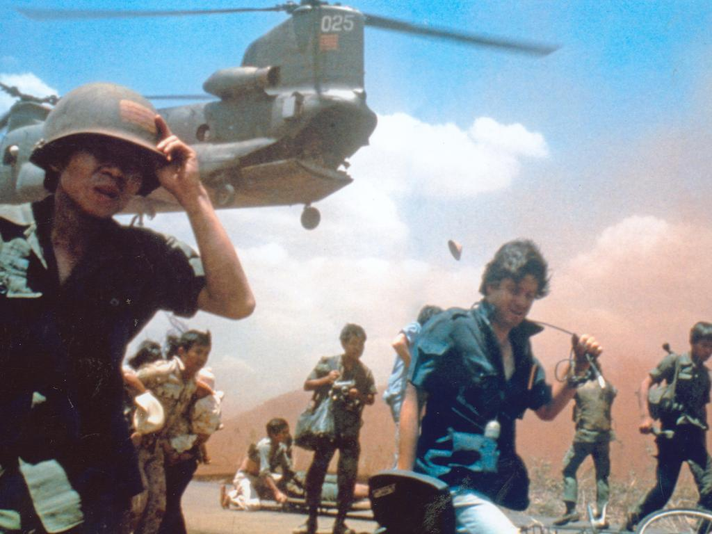 Iconic image of Aussie cameraman David Brill, trying to get evacuated four days before the fall of Saigon.