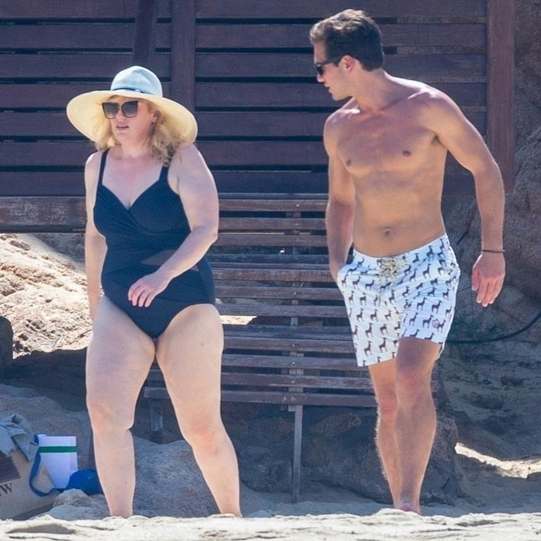 Rebel Wilson shows off her slimmed down beach body while on romantic getaway with boyfriend, Jacob Busch. Picture: Backgrid