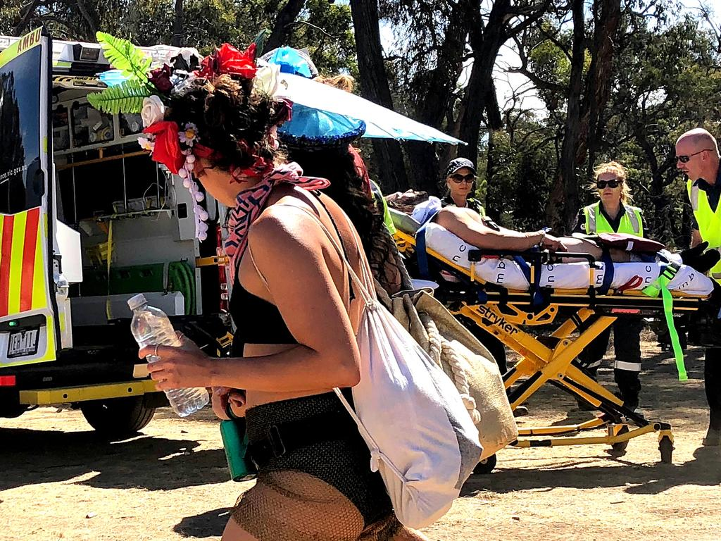 A man is loaded into an ambulance at the Rainbow Serpent Festival in Victoria.