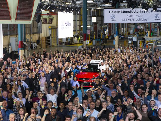 Workers pose with the last Holden. Picture: AAP/Holden Pressroom