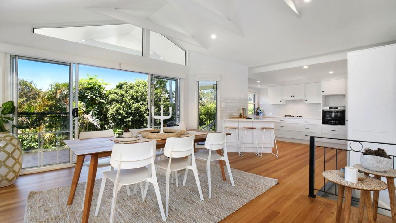 Open-plan kitchen, living and dining with contemporary finishes.