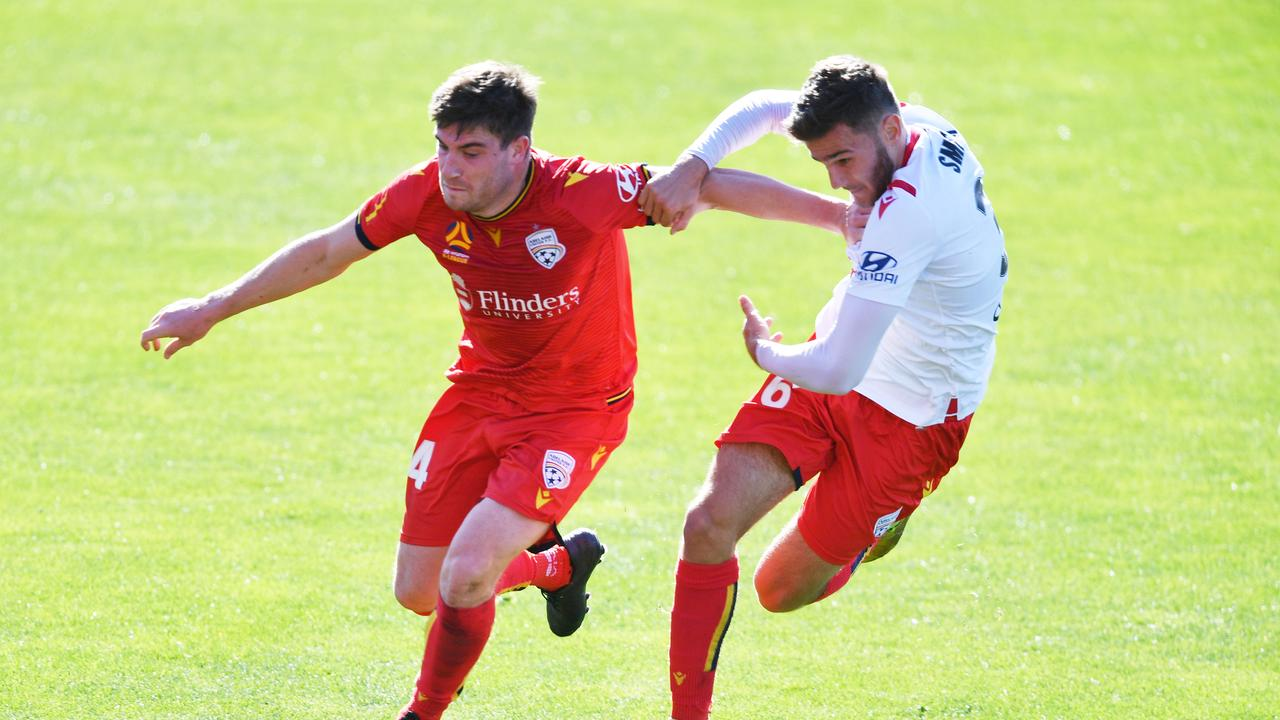Adelaide United pair Ryan Strain and Noah Smith prepare for the A-League season resumption. Picture: AAP Image/David Mariuz