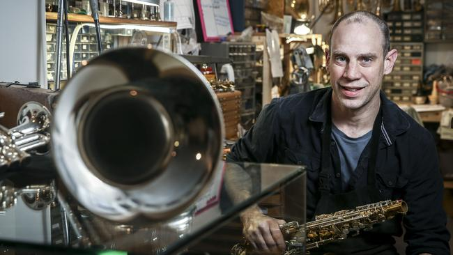 Bret Gustafson in his music shop Gustafson Custom Horns in Gawler Place. Picture: Mike Burton
