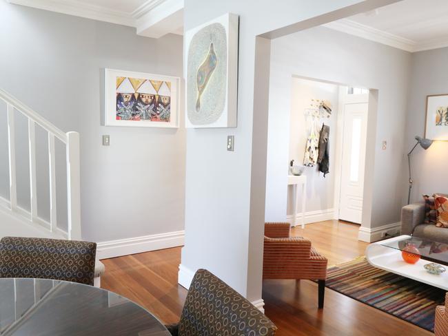 Hallways create gallery spaces for original artwork.
