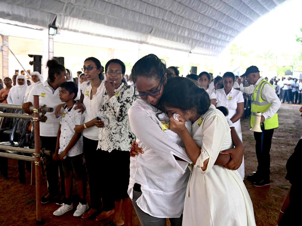 Two women weep  during a funeral service for bomb blast victims at St Sebastian's Church in Negombo. Picture: AFP