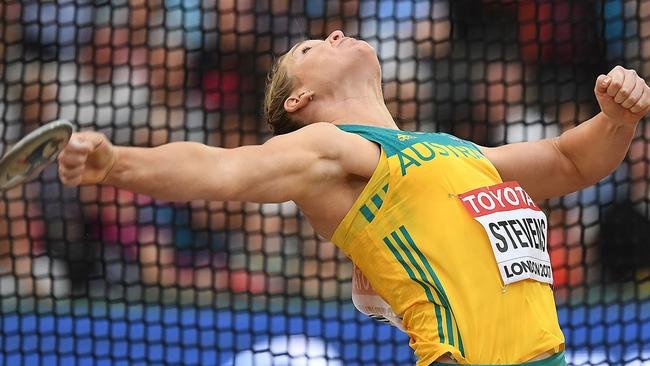 Dani Stevens launches the discus at the world championships. Picture: AFP Photo