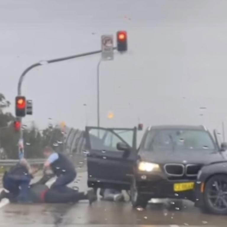 The driver was dragged from the car by police. Picture: TikTok/leah_t.c.f