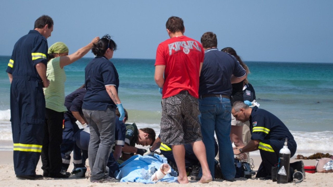 Paramedic crews on the scene as the young man received emergency treatment for his injuries. Picture: Caters News Agency