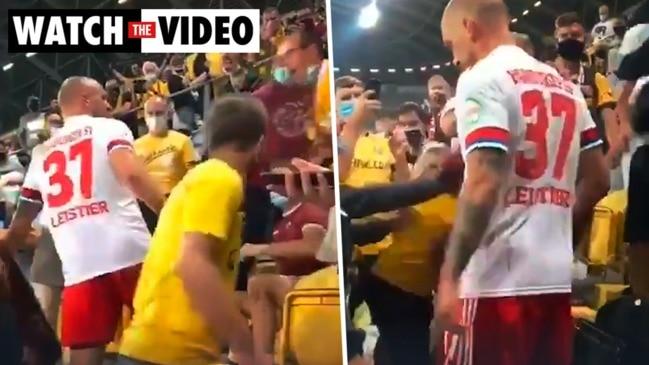 Footballer jumps into stands, attacks fan