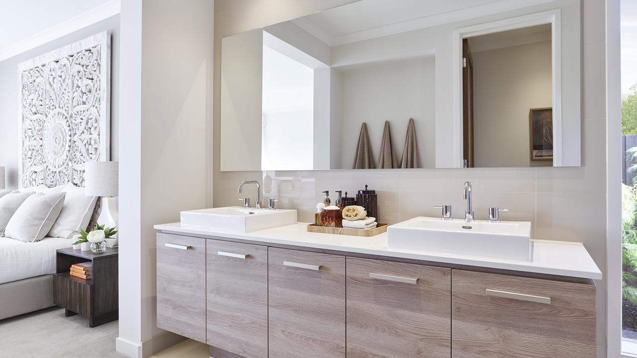 The ensuite with double vanity is part of the main bedroom's appeal.